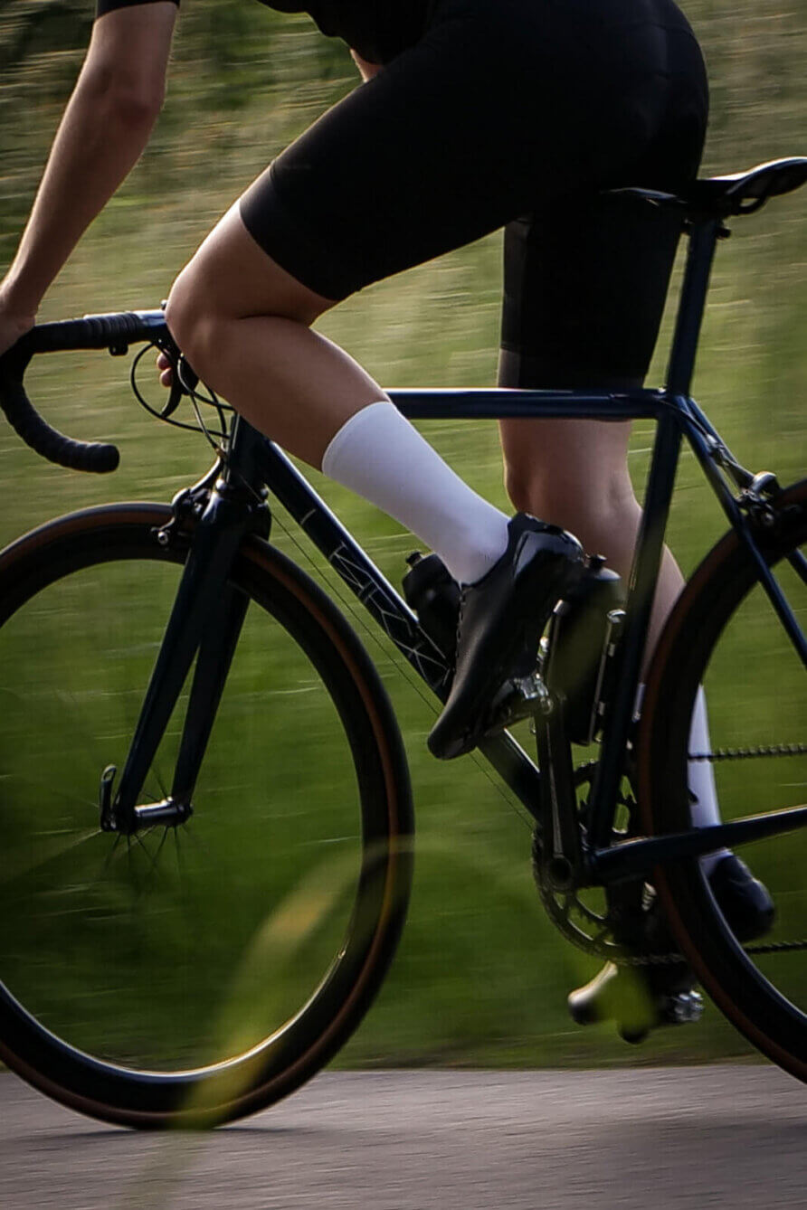 white nologo cycling socks in motion