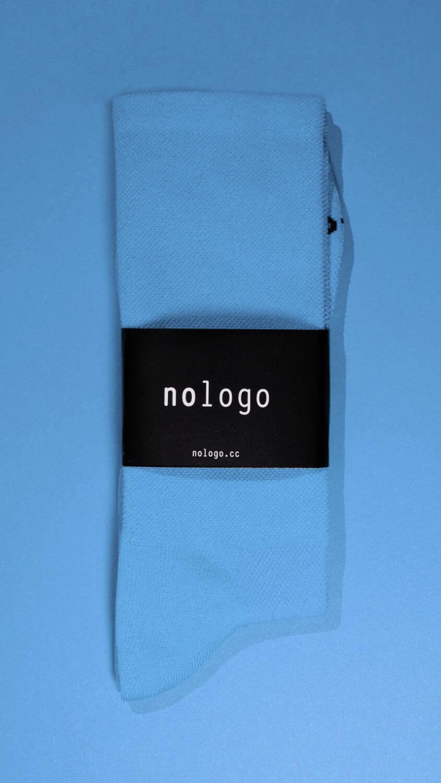 nologo blue cycling socks on blue background
